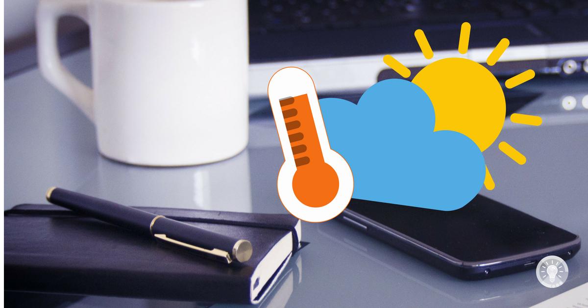 Schreibtischaufnahme mit Grafik Sonne und Thermometer