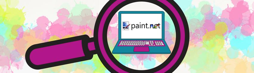 Lila Lupe mit Fokus auf Laptop mit Paint.net Logo auf dem Bildschirm